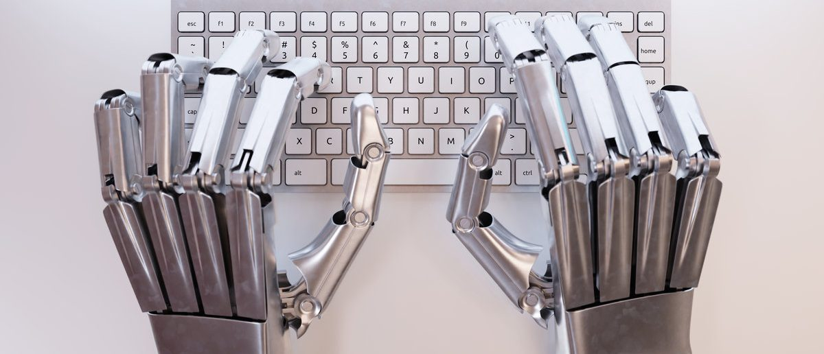 Robot typing on conceptual keyboard (Shutterstock/maxuser)