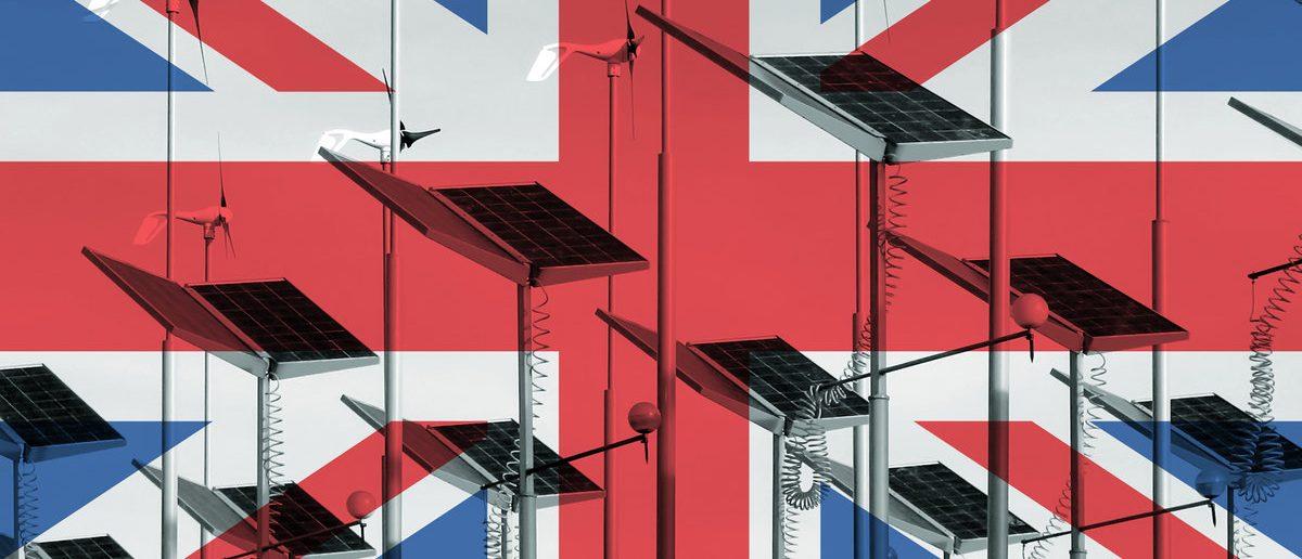 UK flag overlaid over wind generators and solar panels (Shutterstock/Yorkman)