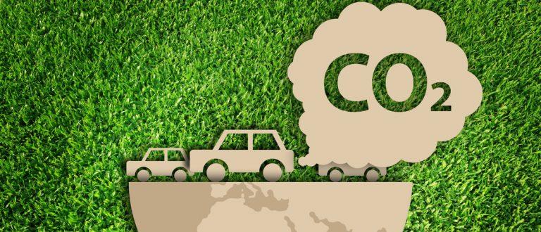 Carbon dioxide. Air Pollution concept. Paper cut of eco on green grass. (Shutterstock/Vanatchanan)