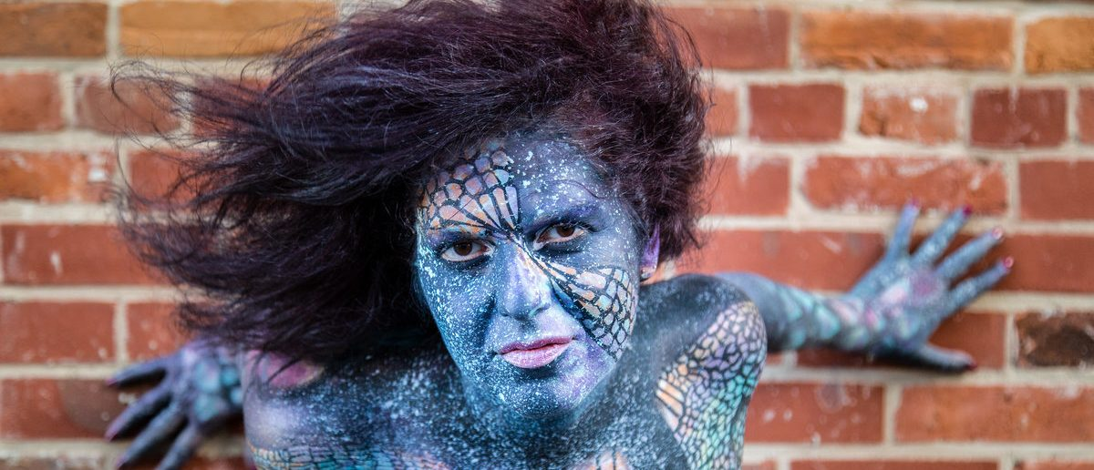 Model in Body Paint with Blue Face (Shutterstock/Shawn Goldberg)