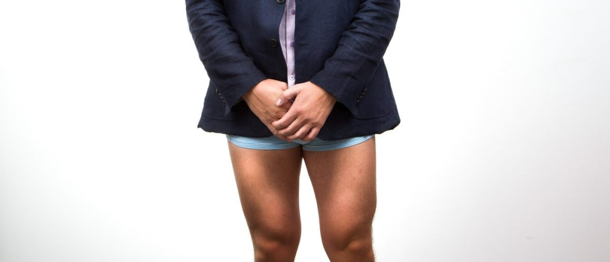 Man brought before judge with a suit jacket, but no pants. [Shutterstock - gmlykin - 298248377]