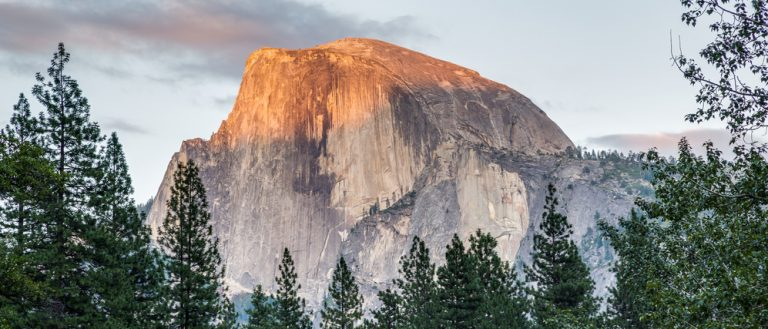 A view of Half-Dome from Yosemite National Park village. (Photo: Shutterstock)