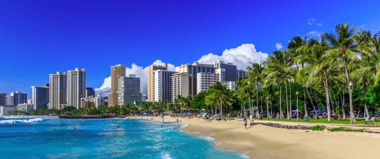 What vacation slideshow would be complete without the stunning white sand of Waikiki beach? (Photo: Shutterstock)