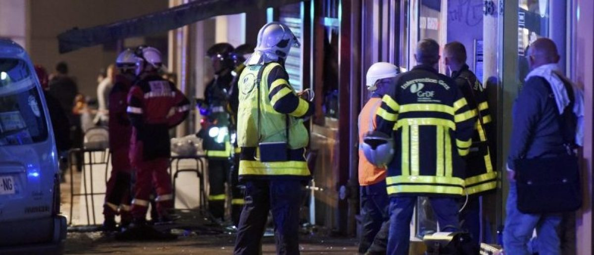 French firemen and rescue crew gather after a fire swept through a bar overnight, killing 13 people and injuring six, after a birthday cake with candles and sparklers fell to the floor and set the carpet ablaze, police said, in Rouen, France, August 6, 2016. REUTERS/Boris Maslard