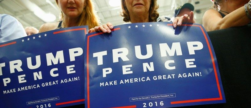 Supporters are seen as Republican presidential nominee Donald Trump attends a campaign event at Windham High School in Windham, New Hampshire August 6, 2016. REUTERS/Eric Thayer