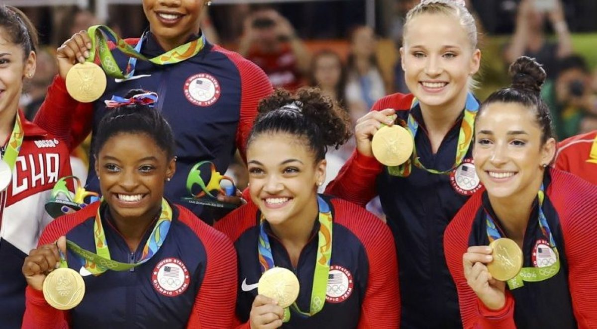 Simone Biles, Gabrielle Douglas, Laurie Hernandez, Madison Kocian, and Alexandra Raisman pose with their gold medals. REUTERS/Mike Blake