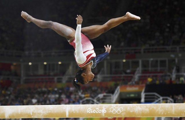 2016 Rio Olympics - Artistic Gymnastics - Final - Women's Team Final - Rio Olympic Arena - Rio de Janeiro, Brazil - 09/08/2016. Simone Biles (USA) of USA competes on the beam during the women's team final. REUTERS/Dylan Martinez