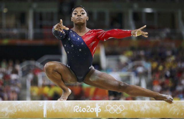2016 Rio Olympics - Artistic Gymnastics - Preliminary - Women's Qualification - Subdivisions - Rio Olympic Arena - Rio de Janeiro, Brazil - 07/08/2016. Simone Biles (USA) of USA competes on the beam during the women's qualifications. REUTERS/Damir Sagolj