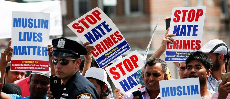 Community members take part in a protest to demand stop hate crime during the funeral service of Imam Maulama Akonjee, and Thara Uddin in the Queens borough of New York City, August 15, 2016. REUTERS/Eduardo Munoz
