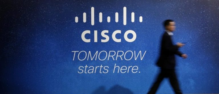 A visitor walks past a Cisco advertising panel at the Mobile World Congress in Barcelona February 27, 2014. REUTERS/Albert Gea/File Photo