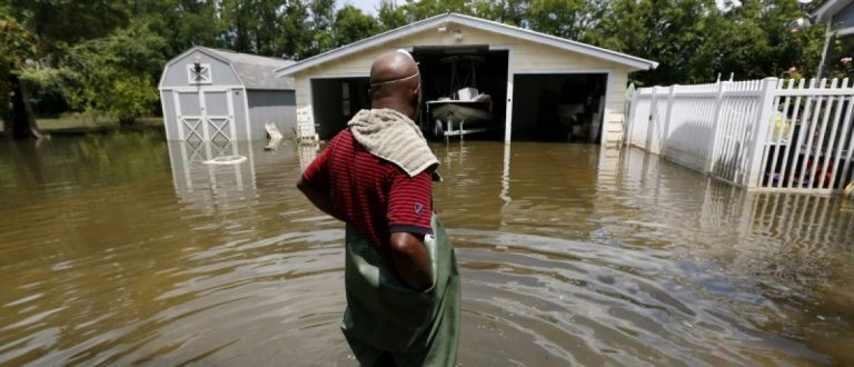Kevin Grey looks at his flood damaged property in Sorrento