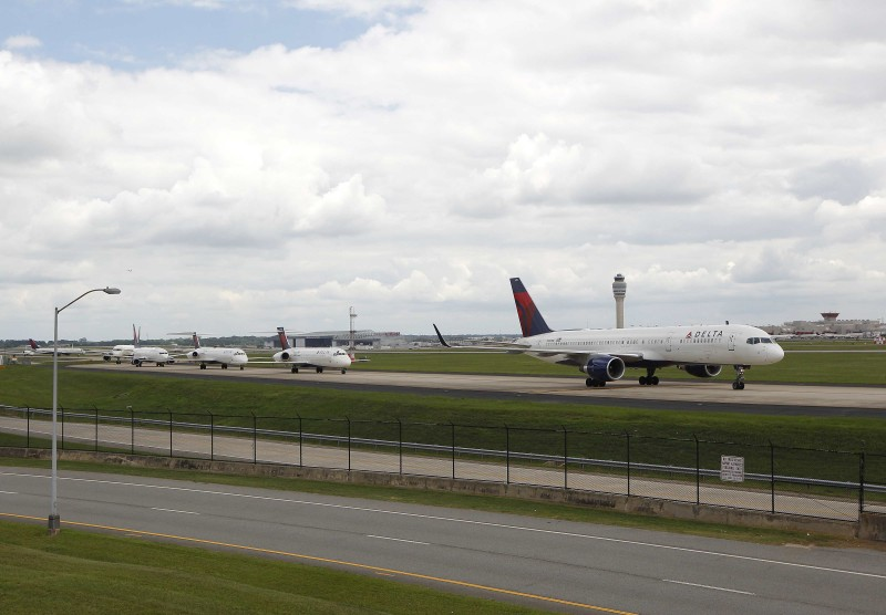 Delta airplanes line up on the taxi way at Hartsfield Jackson Atlanta International Airport in Atlanta, Georgia, U.S. August 8, 2016. REUTERS/Tami Chappell