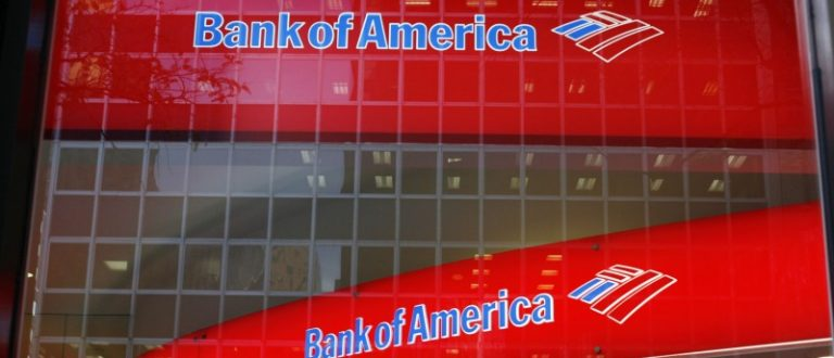 Reflections are seen in the windows of a Bank of America branch in New York