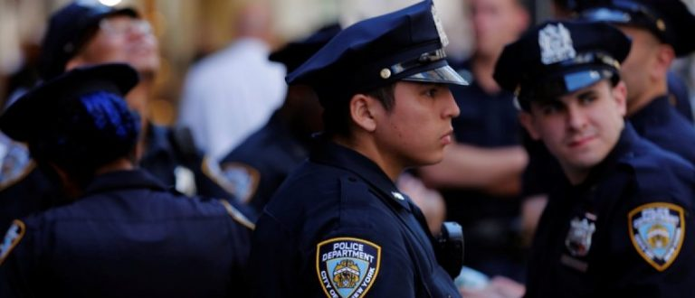 New York Police Department officers stand on 5th Avenue in New York, U.S., August 23, 2016. REUTERS/Lucas Jackson