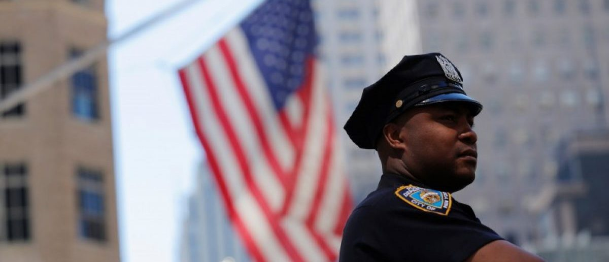 A New York Police Department officer stands on 5th Avenue in New York, U.S., August 23, 2016.  REUTERS/Lucas Jackson