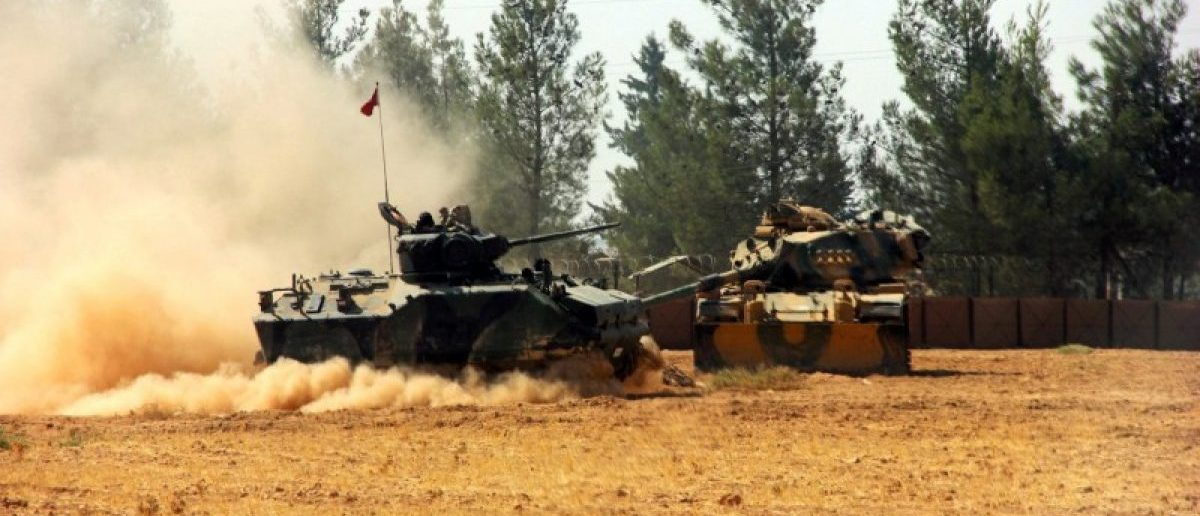 A Turkish army tank and an armoured vehicle are stationed near the Turkish-Syrian border in Karkamis in the southeastern Gaziantep province, Turkey, August 23, 2016. Picture taken August 23, 2016. Ihlas News Agency via REUTERS