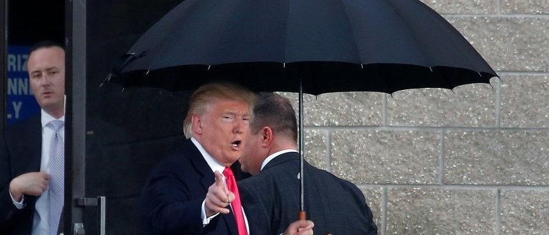Republican presidential nominee Donald Trump arrives in the rain for a campaign rally in Tampa