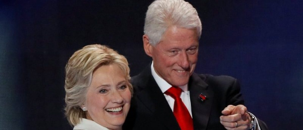 U.S. Democratic presidential nominee Hillary Clinton stands with her husband, former President Bill Clinton, after accepting the nomination on the final night of the Democratic National Convention in Philadelphia, Pennsylvania, U.S. July 28, 2016. REUTERS/Mike Segar/File Photo