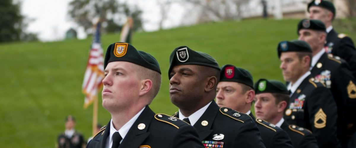 Special Forces Green Beret soldiers from each of the Army's seven Special Forces Groups stand silent watch during the wreath-laying ceremony at the grave of President John F. Kennedy, Nov. 17, 2011, From: US Army/Flickr/Creative Commons