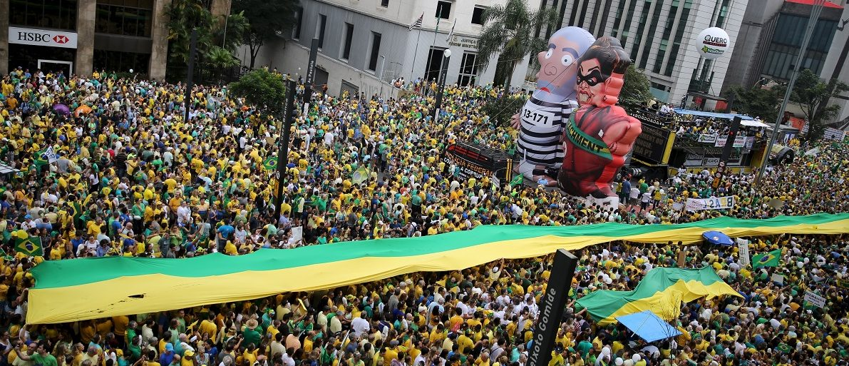 "Inflatable dolls known as ""Pixuleco"" of Brazil's former President Luiz Lula da Silva and Brazil's President Rousseff are seen during a protest against Rousseff, part of nationwide protests calling for her impeachment, in Sao Paulo"