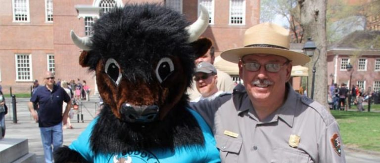 The National Parks Trust Mascot Buddy Bison Poses With A Ranger. Photo: NPS photo