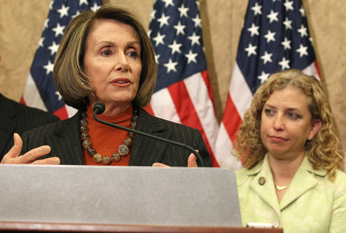WASHINGTON, DC - MARCH 10: House Minority Leader Nancy Pelosi (D-CA)(L), speaks while flanked by Rep. Debbie Wasserman Schultz (D-FL)(R), during a news conference at the U.S. Capitol March 10, 2011 in Washington, DC. Nearing the one year anniversary of the Affordable Care Act, Minority Leader Pelosi spoke about the benefits and rights, Americans are already seeing with the enactment of the law. (Photo by Mark Wilson/Getty Images)