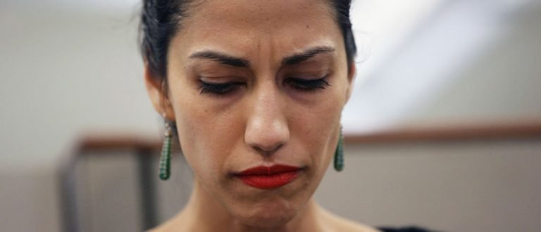 NEW YORK, NY - JULY 23:  Huma Abedin, wife of Anthony Weiner, a leading candidate for New York City mayor, listens as her husband speaks at a press conference on July 23, 2013 in New York City. Weiner addressed news of new allegations that he engaged in lewd online conversations with a woman after he resigned from Congress for similar previous incidents.  (Photo by John Moore/Getty Images)