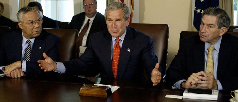 US President George W. Bush(C) delivers a few words to the media on the growth of the economy before a Cabinet meeting 07 October, 2003 at the White House in Washington, DC. US Secretary of State Colin Powell(L) and Deputy Secretary of Defense Paul Wolfowitz(R) look on. AFP PHOTO/Paul J. Richards (Photo credit should read PAUL J.RICHARDS/AFP/Getty Images)