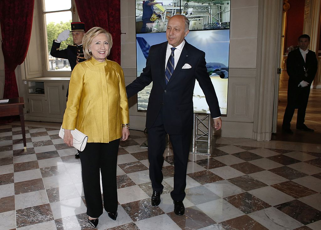 Hillary Clinton (L) is welcomed by French Foreign Minister Laurent Fabius during a visit to Paris (Getty Images)