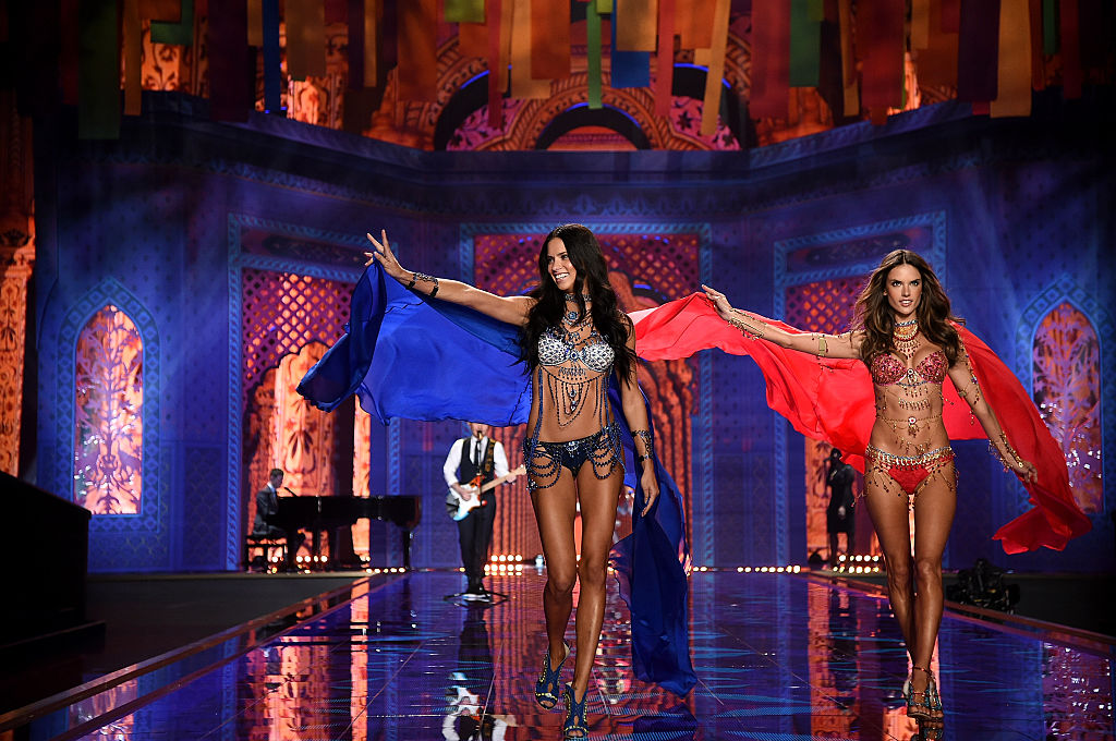 Two Brazilian beauties Adriana Lima and Alessandra Ambrosio strut down the runway together in London. (Photo by Dimitrios Kambouris/Getty Images for Victoria's Secret)