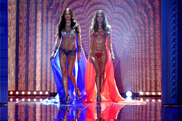 LONDON, ENGLAND - DECEMBER 02: Alessandra Ambrosio and Adriana Lima walk the runway at the annual Victoria's Secret fashion show at Earls Court on December 2, 2014 in London, England. (Photo by Pascal Le Segretain/Getty Images)