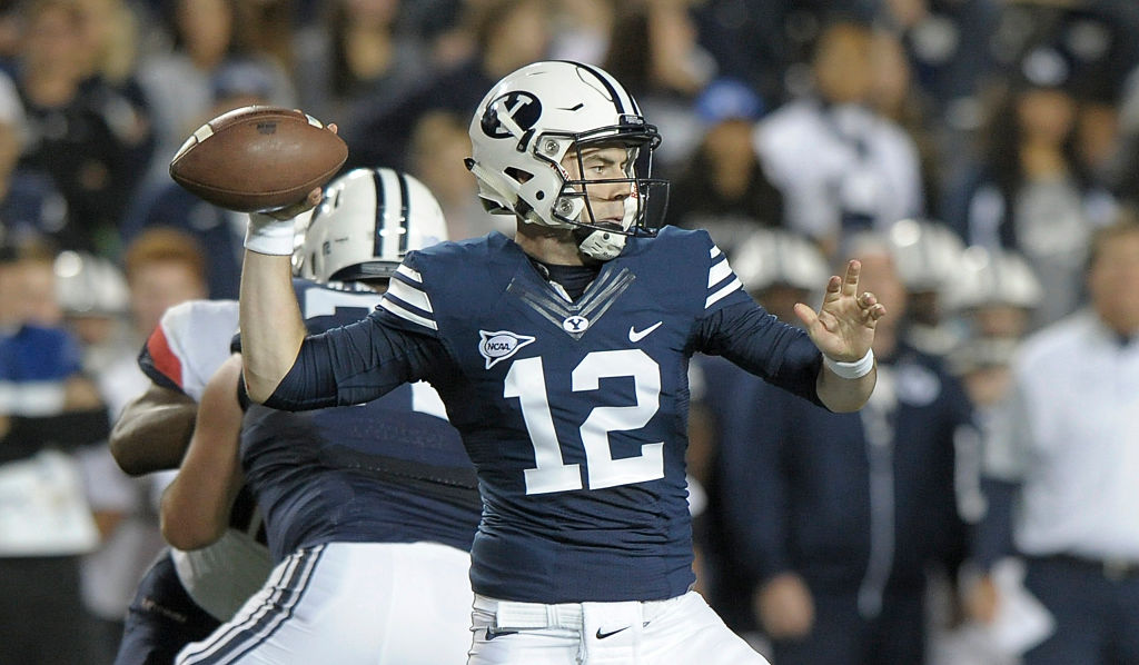 Quarterback Tanner Mangum of the Brigham Young Cougars throws a pass during their game against the Connecticut Huskies at LaVell Edwards Stadium on October 2, 2015 (Getty Images)