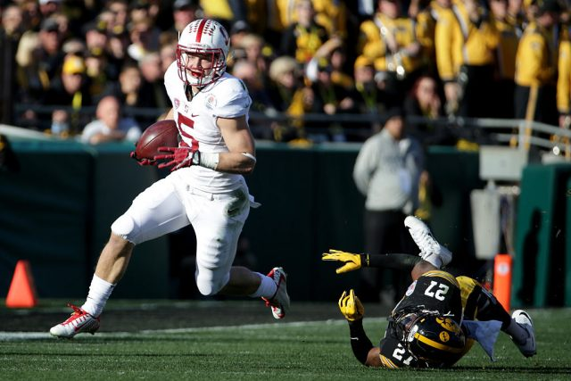 PASADENA, CA - JANUARY 01: Christian McCaffrey #5 of the Stanford Cardinal runs past Jordan Lomax #27 of the Iowa Hawkeyes in the first quarter of the 102nd Rose Bowl Game on January 1, 2016 at the Rose Bowl in Pasadena, California. (Photo by Jeff Gross/Getty Images)