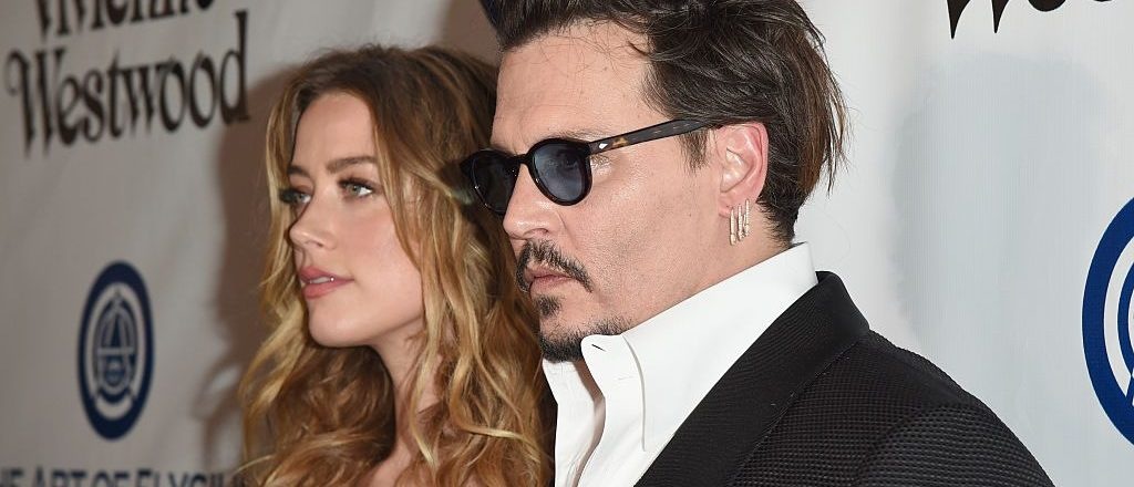 Actors Amber Heard (L) and Johnny Depp attend The Art of Elysium 2016 HEAVEN Gala in January 2016 in Culver City, California
