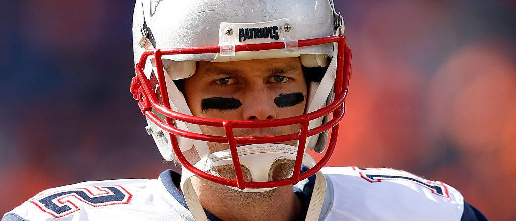 Tom Brady of the New England Patriots warms up prior to the AFC Championship game against the Denver Broncos at Sports Authority Field at Mile High on January 24, 2016 in Denver, Colorado