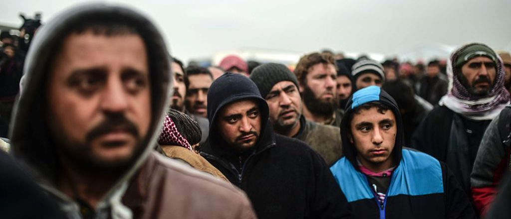 Syrian refugees wait outside the embattled city of Aleppo (Getty Images)