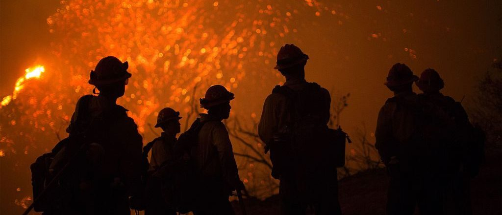 These firefighters deserve to be thanked. (Photo credit should read DAVID MCNEW/AFP/Getty Images)