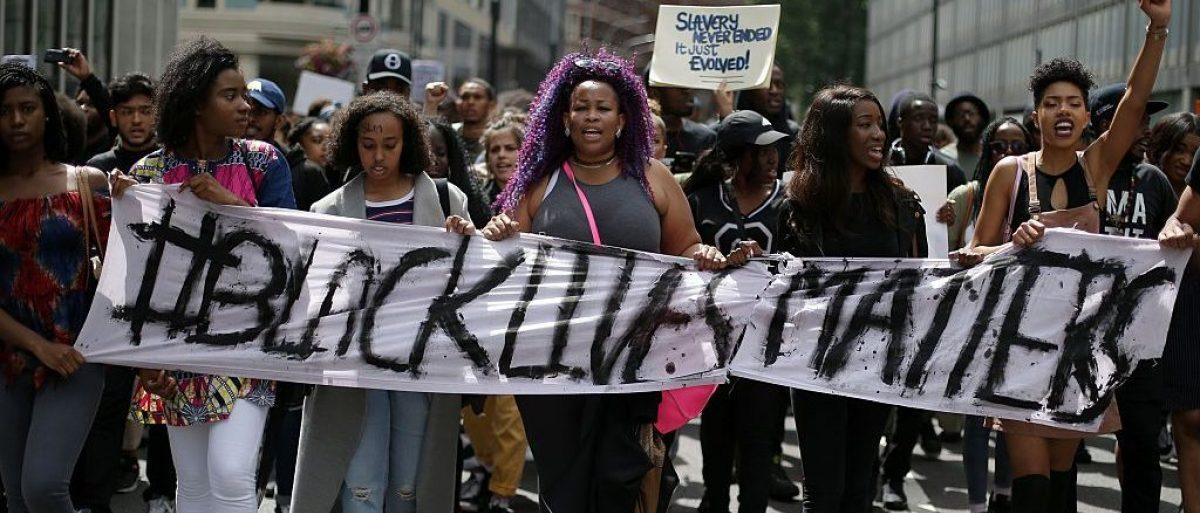 Demonstrators from the Black Lives Matter movement march through the streets of central London on July 10, 2016 (Getty Images)