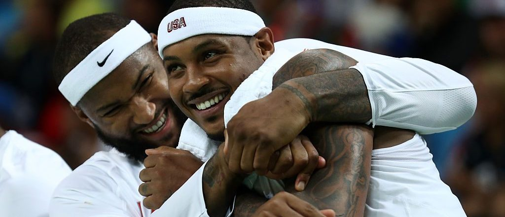 Demarcus Cousins #12 of United States and Carmelo Anthony #15 of United States react on the bench during the game against Venezuela in the men's preliminary round group A game 19 on Day 3 of the Rio 2016 Olympic Games at the Carioca Arena 1 on August 8, 2016 in Rio de Janeiro