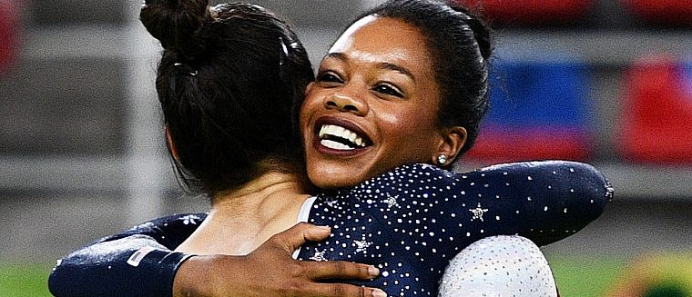Alexandra Raisman (L) and Gabrielle Douglas (R) of the United States celebrate winning the gold medal during the Artistic Gymnastics Women's Team Final on Day 4 of the Rio 2016 Olympic Games at the Rio Olympic Arena on August 9, 2016 in Rio de Janeiro, Brazil. (Photo by David Ramos/Getty Images)