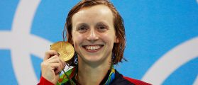Gold medalist Katie Ledecky of the United States poses on the podium during the medal ceremony for the Women's 200m Freestyle Final on Day 4 of the Rio 2016 Olympic Games at the Olympic Aquatics Stadium on August 9, 2016 in Rio de Janeiro, Brazil. (Photo by Adam Pretty/Getty Images)