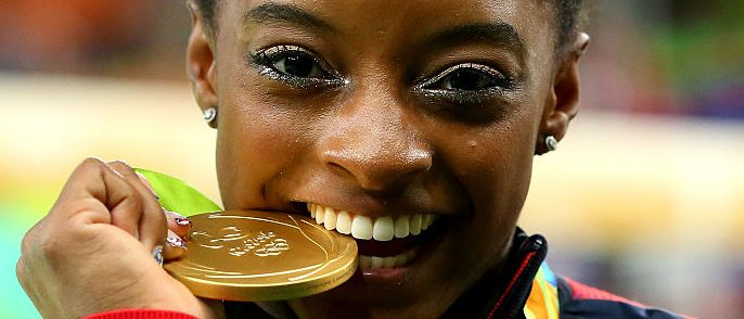 Gold medalist Simone Biles of the United States poses for photographs after the medal ceremony for the Women's Individual All Around on Day 6 of the 2016 Rio Olympics at Rio Olympic Arena on August 11, 2016 in Rio de Janeiro, Brazil