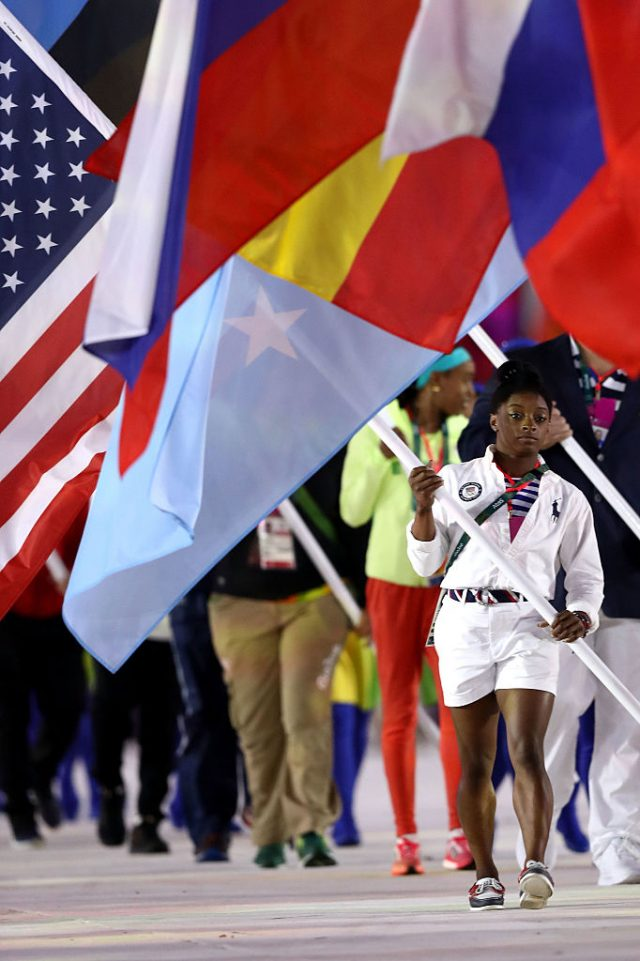 Flag bearer Simone Biles of United States walks during the 'Heroes of the Games' segment during the Closing Ceremony on Day 16 of the Rio 2016 Olympic Games at Maracana Stadium on August 21, 2016 in Rio de Janeiro, Brazil