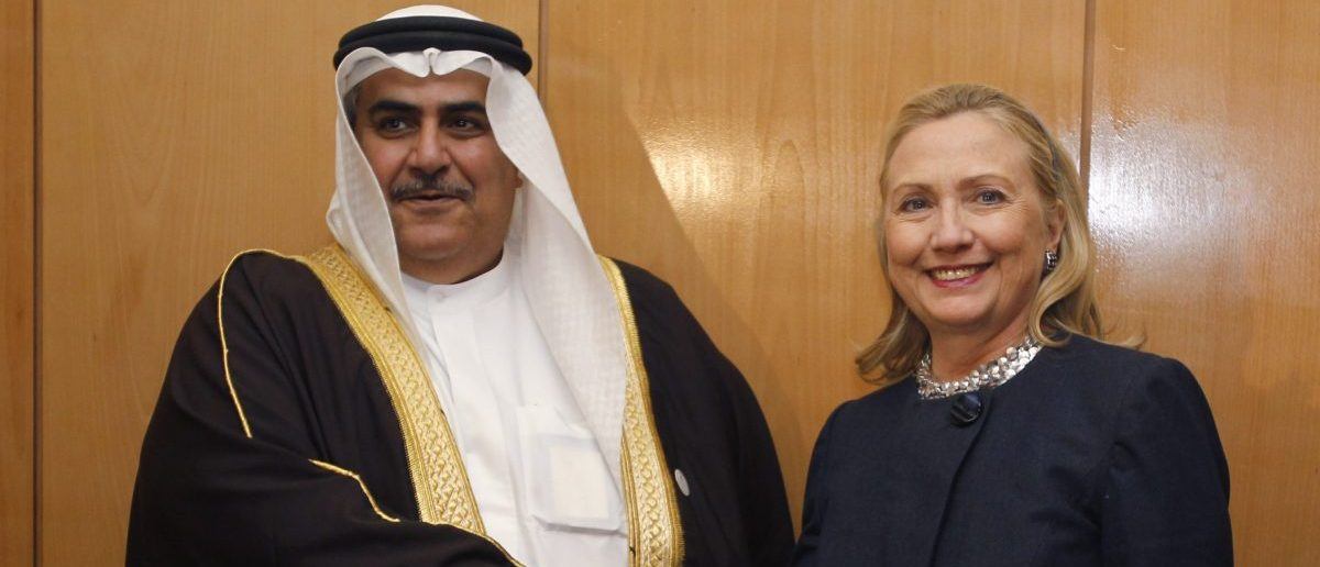 U.S. Secretary of State Hillary Clinton meets with Bahrain's Foreign Minister Sheikh Khaled bin Ahmed al-Khalifa at the Friends of Syria Conference in Tunis, February 24, 2012. REUTERS/Jason Reed