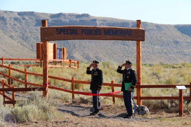 Special Forces Chief Brian Bewley & Major Paul Rosser salute. (Photo: Alex Quade)