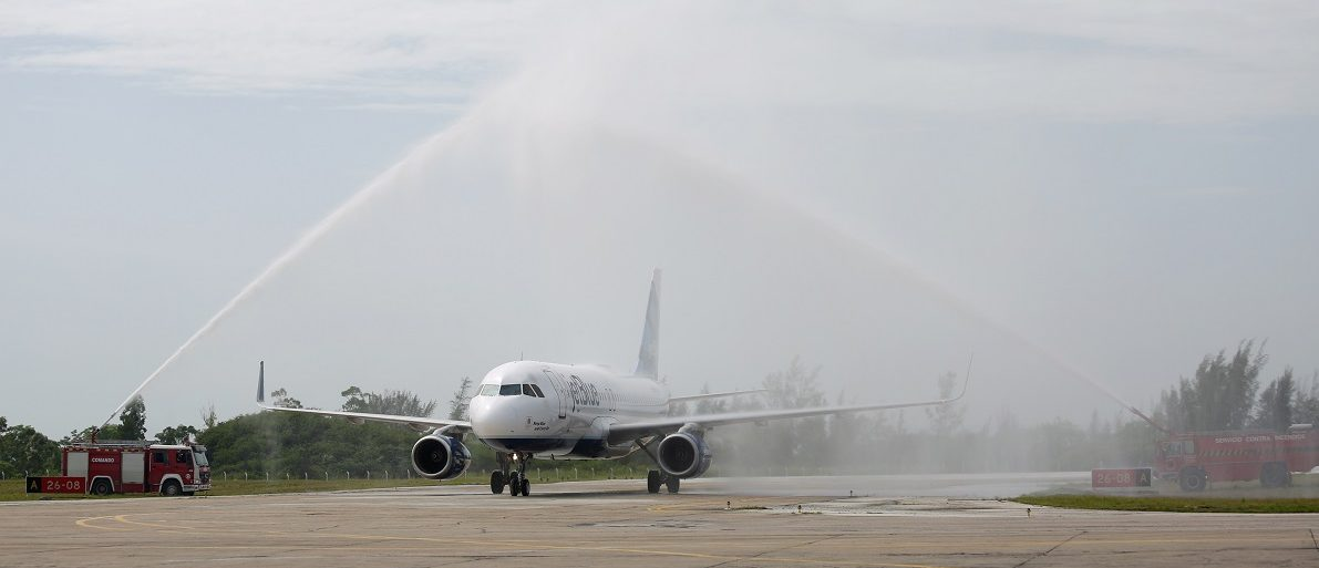 A JetBlue aeroplane, the first commercial scheduled flight between the United States and Cuba in more than 50 years lands at Abel Santamaria International Airport in Santa Clara, Cuba