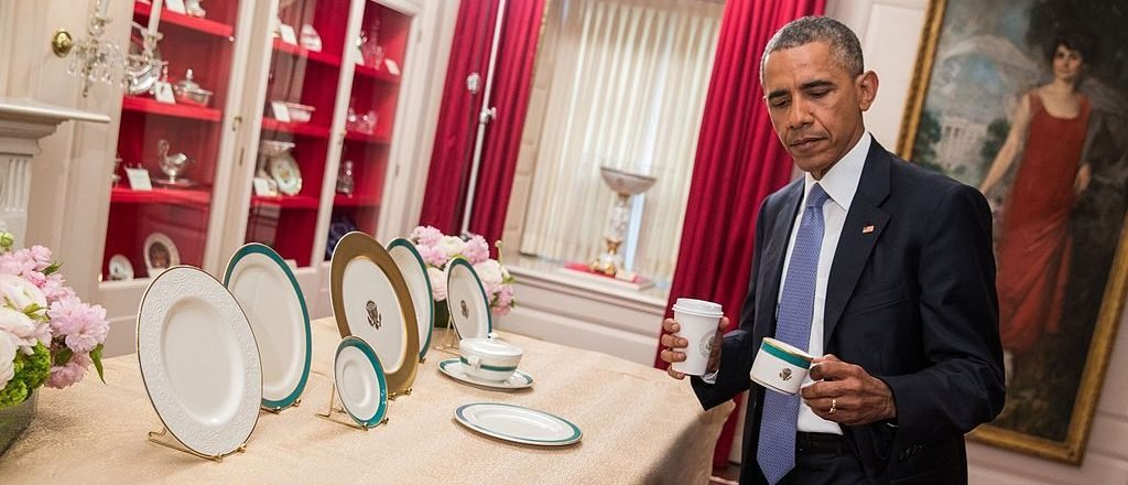 President Barack Obama inspects the new White House china service on April 27, 2015, in the China Room of the White House in Washington, D.C., in the United States. (Wikimedia Commons)