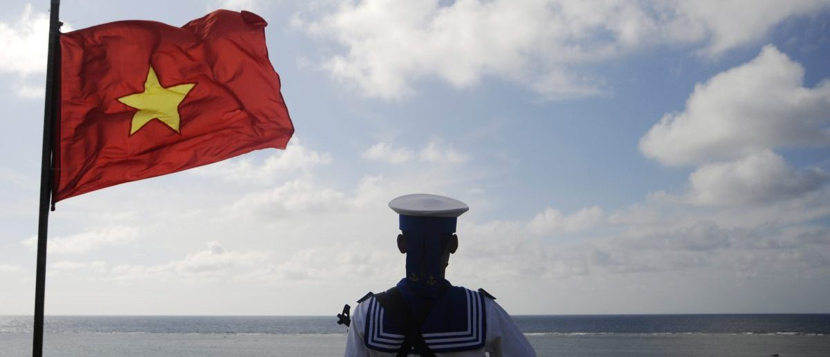 A Vietnamese naval soldier stands quard at Thuyen Chai island in the Spratly archipelago January 17, 2013. A group of anti-China protesters plan to gather on March 14, 2013 to mark the anniversary of the 1988 naval battle between China and Vietnam near Spratly reefs, in which 64 Vietnamese sailors were killed. Both Vietnam and the Philippines have previously complained about Chinese activity and even harassment in contested parts of the South China Sea. China's claim is by far the largest, forming a vast U-shape over most of the sea's 648,000 square miles (1.7 million square km), including the Spratly and Paracel archipelagos. China, Vietnam, the Philippines, Malaysia, Brunei and Taiwan all claim territory in the sea, which covers important shipping routes and is thought to hold untapped oil and gas reserves. Picture taken on January 17, 2013. REUTERS/Quang Le