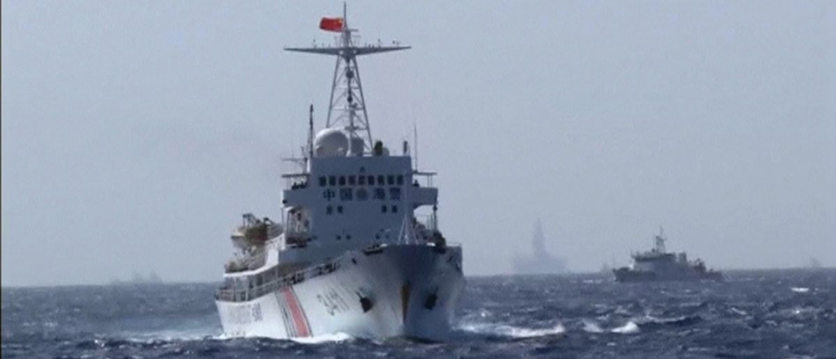 A still image taken from video shows a Chinese Coast Guard vessel sailing in the South China Sea, about 210 km (130 miles) off shore of Vietnam May 14, 2014. Vietnamese ships were followed by Chinese vessels as they neared China's oil rig in disputed waters in the South China Sea on Wednesday, Vietnam's Coast Guard said. Vietnam has condemned as illegal the operation of a Chinese deepwater drilling rig in what Vietnam says is its territorial water in the South China Sea and has told China's state-run oil company to remove it. China has said the rig was operating completely within its waters. REUTERS/Reuters TV