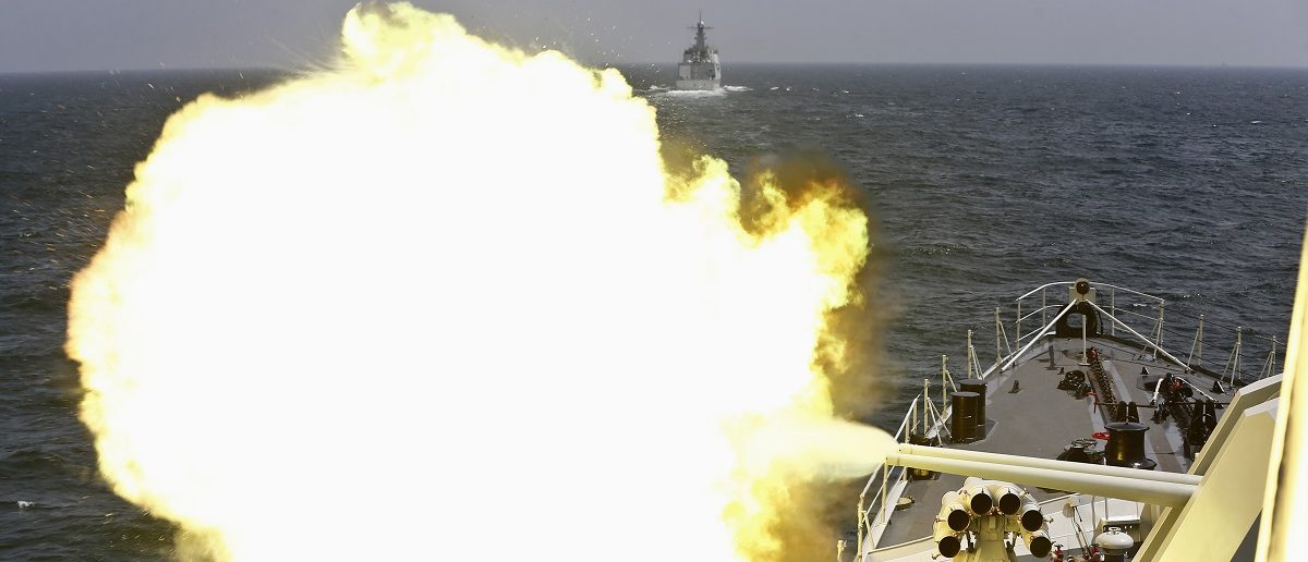 A Chinese navy vessel fires its cannon during the Joint Sea-2014 naval drill outside Shanghai on the East China Sea, May 24, 2014. Chinese and Russian navies staged exercises on the East China Sea on Saturday to simulate anti-submarine and search-and-rescue operations. A total of 14 surface ships, two submarines, nine fixed-wing warplanes, six shipboard helicopters and two operational detachments are taking part in this year's week-long drill, state media reported. Picture taken May 24, 2014. REUTERS/China Daily (CHINA - Tags: POLITICS MILITARY) CHINA OUT. NO COMMERCIAL OR EDITORIAL SALES IN CHINA